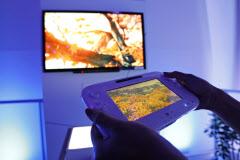「Wii U」は居間の大型テレビなど大画面でも遊べる=ロイター
