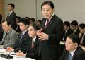 東日本大震災復興対策本部会合であいさつする野田首相(7日午後、首相官邸)=共同
