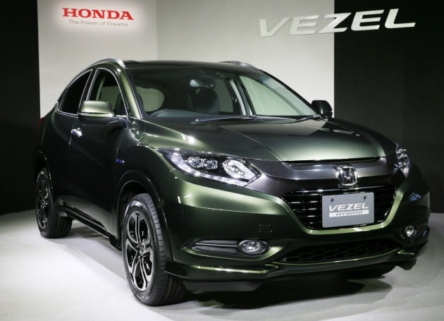 ホンダは世界戦略車となる多目的スポーツ車(SUV)「ヴェゼル」を発表した(19日、東京都港区)