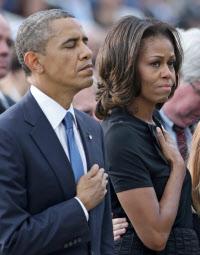 ミシェル・オバマ米大統領夫人(右)は子供の肥満防止のキャンペーンに取り組んでいる(ゲッティ=共同)
