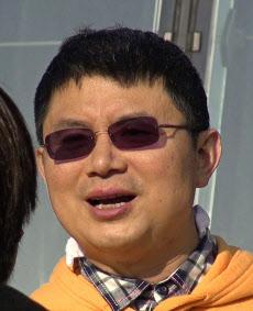 カナダ国籍を持つ大富豪の肖建華氏。彼の失踪の謎は深まるばかりだ=Next Magazine・AP