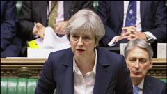 29日、英議会でEU離脱交渉に向け結束を呼びかけるメイ首相=AP