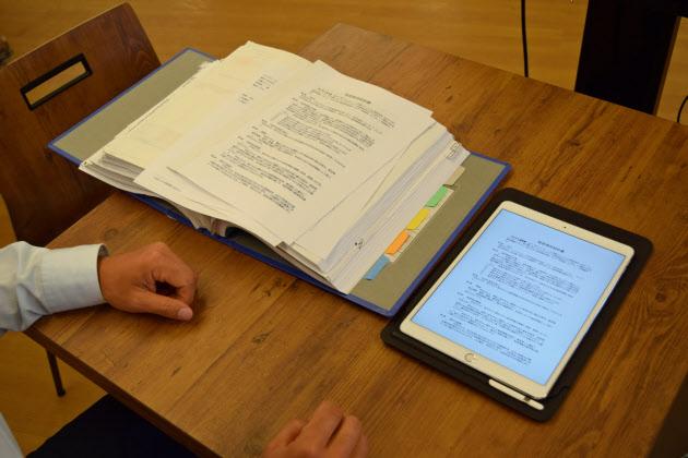 紙の契約書、クラウドで管理 弁護士ドットコム