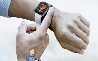 Jeff Williams, Apple's chief operating officer, speaks about the Apple Watch Series 4 at the Steve Jobs Theater during an event to announce new Apple products Wednesday, Sept. 12, 2018, in Cupertino, Calif. (AP Photo/Marcio Jose Sanchez)